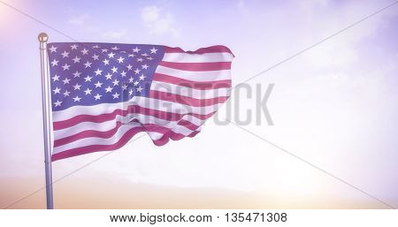 US flag against sunset with clouds