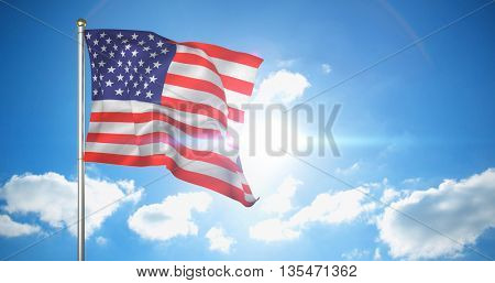 Close up of the us flag against cloudy sky with sunshine