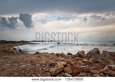 Dark sky rocky coast and stormy sea. Tarragona Catalonia Spain.