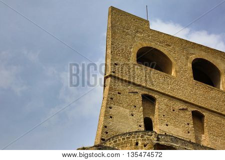 Detail of Castel Sant Elmo a medieval fortress located on a hilltop overlooking Naples Italy. HDR image.