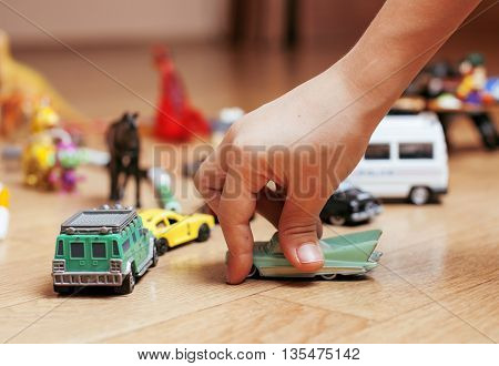 children playing toys on floor at home, little hand in mess, free education, lifestyle people concept