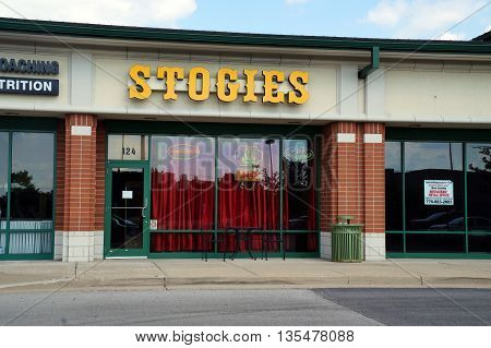 NAPERVILLE, ILLINOIS / UNITED STATES - JULY 23, 2015: One may purchase cigars and other tobacco products at Stogies, in a Naperville strip mall.