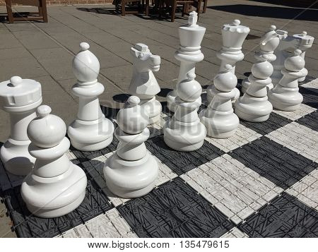 White pieces to a life size chess game.