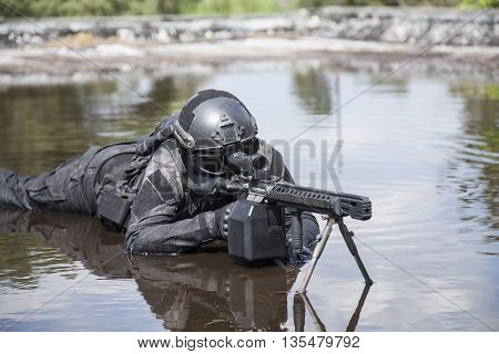 Spec ops police officer SWAT in action in the water