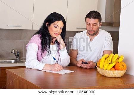 Sad Couple Calculate Their Bills