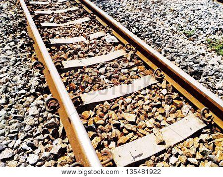 Railroad tracks in vintage color mode .