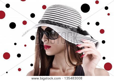 Elegant woman with hat and pois on background