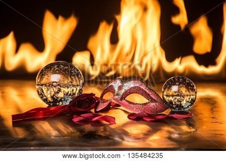 still life of fire and mask with spheres