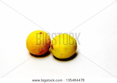 Two yellow lemons with top lighting isolated on white background
