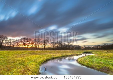 Sunset Creek With Blurred Clouds