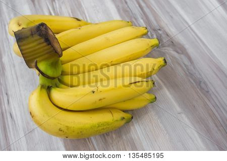 Fresh bananas on wooden table