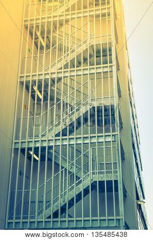 Metal fire escape outside building ( Filtered image processed vintage effect. )