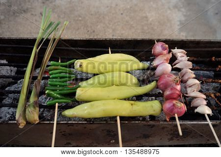 grilled pepper red onion garlic and lemongrass for prepare the Thai chili paste