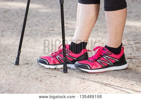 Legs Of Elderly Senior Woman And Nordic Walking Sticks, Sporty Lifestyles