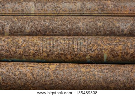 Texture and detail of rust on steel pipes