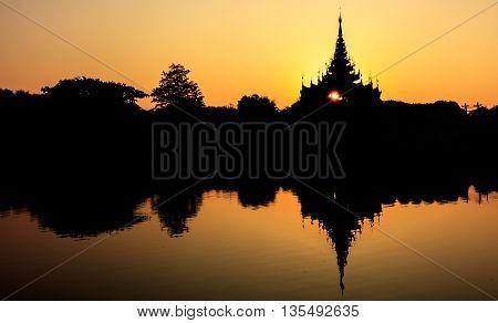 Silhouette mandalay royal palace at sunrise Mandalay Myanmar