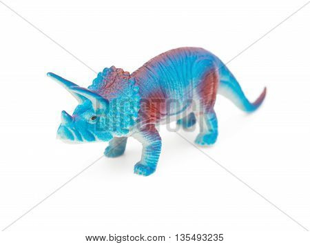 blue triceratops toy on a white background