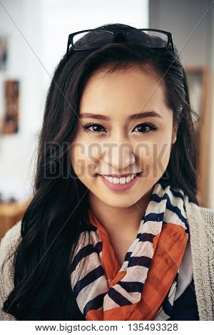 Portrait of beautiful Asian girl smiling at camera