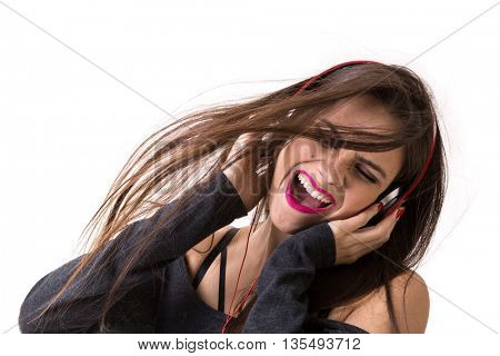 Brunette latina girl listening to music on white background