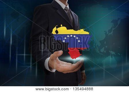 Businessman showing map of Venezuela on globe background