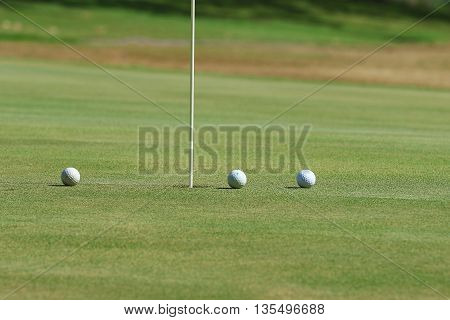 Golf ball on grass in golf course