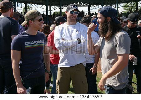 ARLINGTON, TX - APR 18: (L-R) Dustin Lynch, Chase Rice and TV personality Jep Robertson attend the ACM & Cabela'??s Great Outdoor Archery Event at the Texas Rangers Youth Ballpark on April 18, 2015.