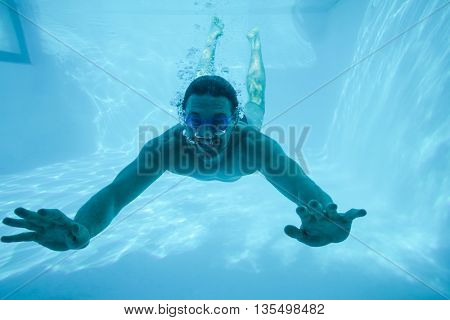 Man swimming under swimming pool at resort