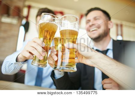 Clinking glasses of beer
