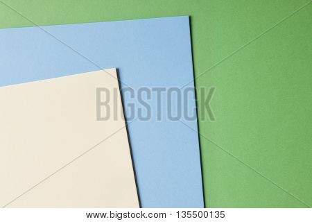 Colored cardboards background in beige blue green tone. Copy space. Horizontal