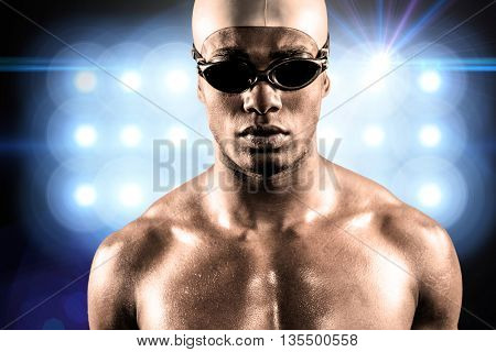 Composite image of swimmer ready to dive against spot light