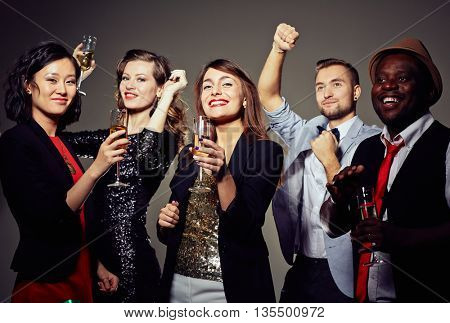 Portrait of young people at party with champagne