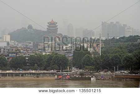 Yellow Crane Tower and other buildings nearly Yangtze river in Wuhan, China