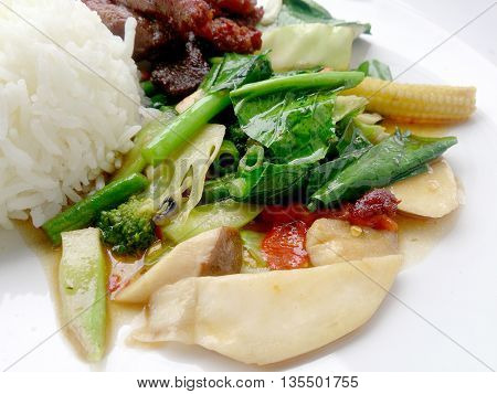 Egetable Stir Fry And Fried Pork In A Plate & Thai Jasmine Rice. Top View