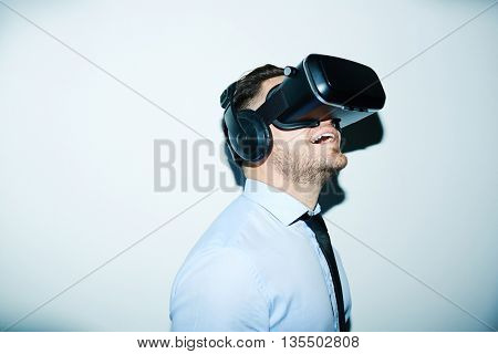 Businessman wondering opportunities of vr simulator