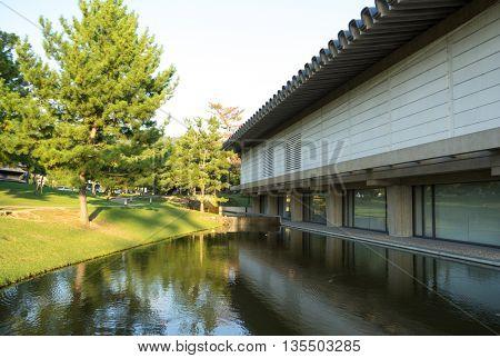 building near water in park in japan hokkaido