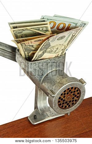 Money concept with dollar banknotes in meat grinder on wooden table taken closeup.