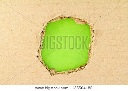 Brown torn paper over paper green background