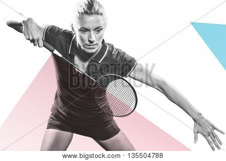 Badminton player playing badminton against pink and blue