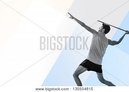 Profile view of sportsman practising javelin throw against colored background