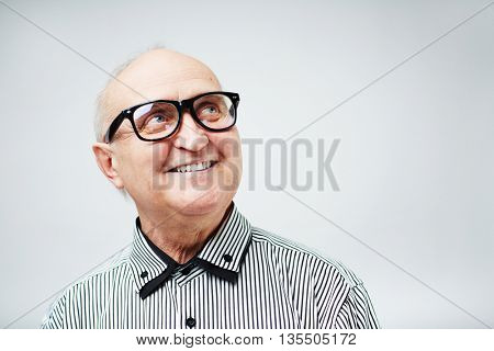 Portrait of a smiling senior man in eyeglasses