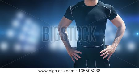 Portrait of athletic man chest against composite image of spotlight