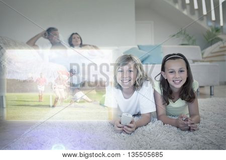 Siblings on the floor watching tv against rugby players tackling during game