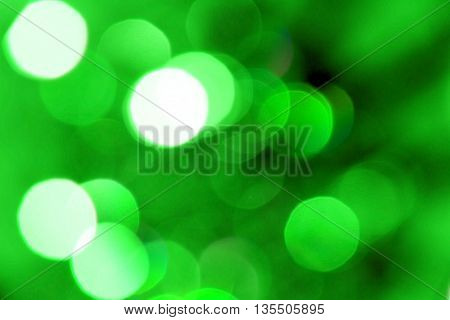 Blurred reflections of the light. Unfocused image of green light.