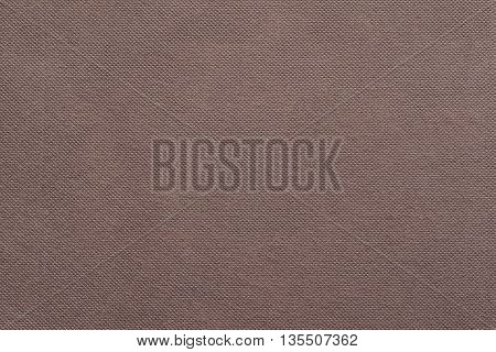 the grooved textured design of fabric with pile for the abstract background and for wallpaper of brown color