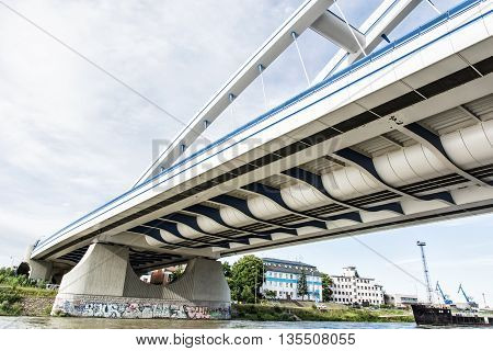 Modern Apollo bridge in Bratislava Slovak republic. Architectural theme. Ship transportation. Infrastructure theme. Danube river.