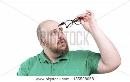 Man Looks At Glasses..