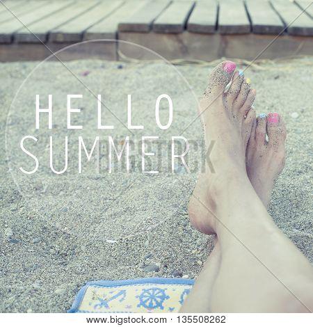 Hello summer / Feet relaxing on sandy beach
