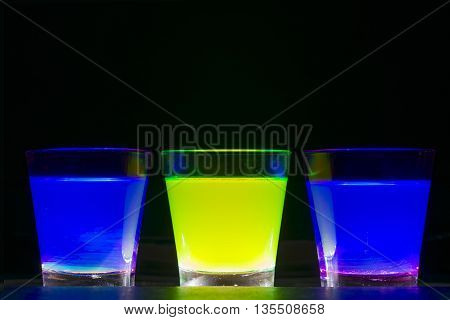 Three different colorful cocktail on black background