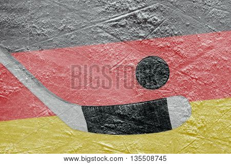 Image of the German flag and hockey puck with the stick on the ice. Concept