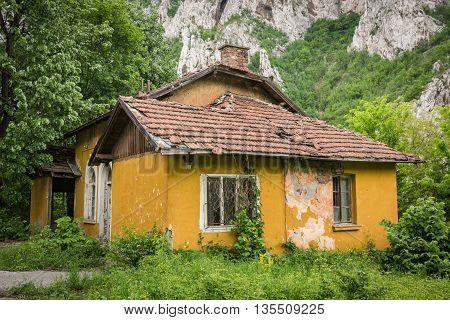 Image of spooky yellow abandoned haunted houses